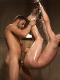 Bound psycho gets his cock and balls tortured and his asshole dicked by brutal bearded man