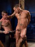 Sexy gay slave with tied up cock and balls gets his ass punished by ruthless man