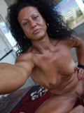 tanned-mature-brunette-with-small-breasts-and-trimmed-pussy-strips-nude
