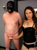 masked-man-gets-his-cut-cock-pinned-spanked-and-stroked-by-curious-mistress