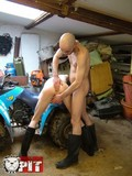 skinny-inked-up-guy-gets-ruthlessly-fucked-by-shaved-headed-gay-in-the-garage