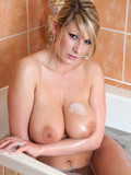 big-titted-wet-babe-shows-every-inch-of-her-perfect-wet-body-after-taking-a-bath