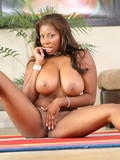 huge-meloned-dark-skinned-bombshell-gets-her-shaved-juicy-pussy-slammed