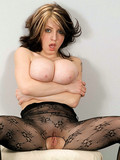 smoking-brunette-with-sexy-monster-boobs-strips-out-of-her-black-body-stocking