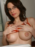 cute-faced-brunette-in-glasses-shows-her-big-boobs-and-neatly-shaved-pussy
