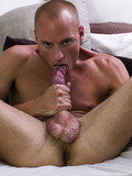 flexible-short-haired-guy-with-tattoo-on-his-back-licks-his-own-cock-and-cums