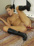 hot-woman-in-black-leather-high-heel-boots-dildos-her-hot-pussy-with-big-desire