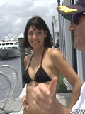brunette-removes-her-black-bikini-then-sucks-and-fucks-captain-s-hard-dick