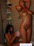 camera-shoots-two-yummy-babes-in-the-shower-room-playing-and-licking-each-other