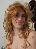 captivating-process-of-a-kinky-crossdresser-making-up-putting-a-wig-on-and-getting-dressed