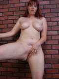 chubby-redhead-shows-her-juicy-tits-then-pulls-off-her-black-panties-and-shows-her-smooth-meaty-cunt