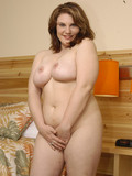 chubby-brunette-chick-with-playful-eyes-gets-nude-and-takes-cock-up-her-shaved-cunt