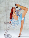 flexible-redhead-in-blue-dress-and-white-panties-makes-no-secret-of-her-bee-stings