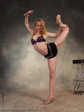 skinny-blonde-in-black-shorts-and-bra-shows-that-she-s-amazingly-flexible