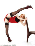 sexy-dressed-gymnast-in-black-stockings-spreads-her-beautiful-long-legs-as-wide-as-possible