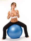 sporty-perfect-boobed-brunette-capri-cavalli-strips-naked-on-a-blue-exercise-ball