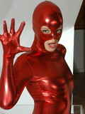 this-perfectly-sculptured-brunette-breathtaker-loves-to-pose-in-her-red-spandex-suit