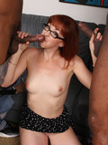 glassed-redhead-in-short-skirt-gets-double-fucked-by-two-black-dudes-in-front-of-her-hubby