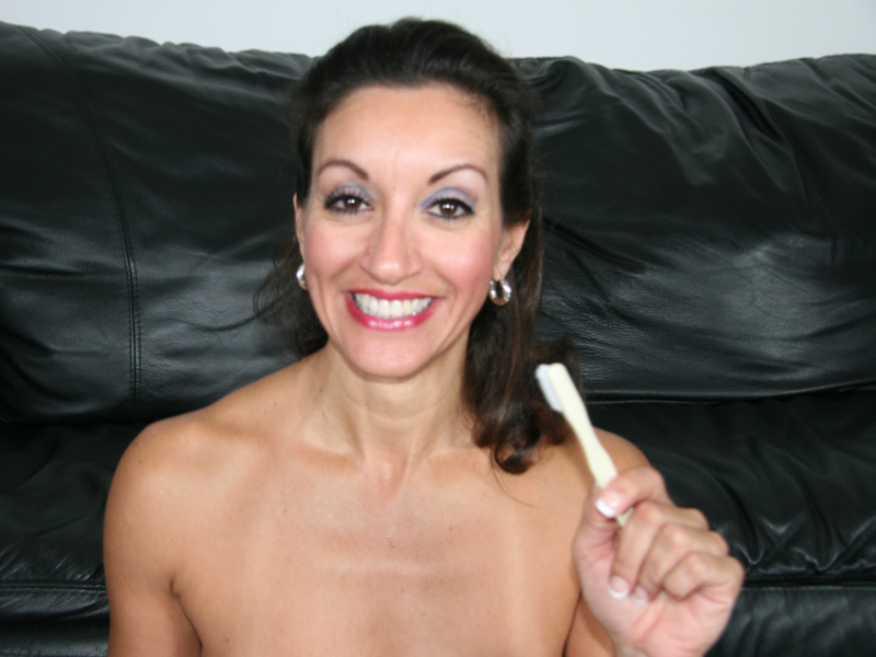 teeth cum with her brush