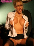busty-stockinged-blonde-in-white-blouse-and-black-skirt-wears-no-bra-and-panties