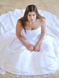 attractive-young-brunette-danielle-poses-in-beautiful-snow-white-wedding-dress