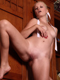 tender-blonde-with-innocent-shaved-pussy-takes-off-her-amazing-red-and-green-suit