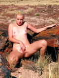 naughty-young-blonde-poses-naked-and-opens-her-legs-in-the-semi-desert