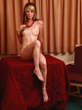 slender-girl-with-hair-of-two-colors-poses-naked-showing-off-her-small-tits
