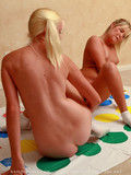 naughty-young-chicks-play-twister-in-the-nude-in-the-middle-of-the-room