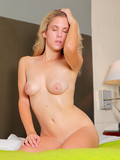 tender-blonde-in-white-t-shirt-shows-off-her-bare-ass-and-soft-smooth-pussy-in-bed