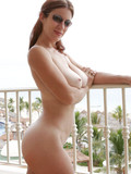 busty-lady-in-shades-strips-out-of-her-bikini-and-shows-her-juicy-body-on-the-balcony