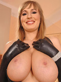 dishy-babe-with-long-black-latex-gloves-touches-her-wonderful-big-knockers
