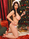 huge-titted-brunette-shows-her-private-parts-after-she-removes-her-christmas-suit