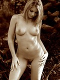 black-and-white-photos-of-perfect-titted-naked-heartbreaker-posing-outdoors