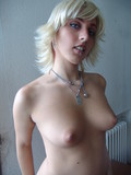 blonde-with-sexy-juicy-ass-and-very-nice-boobies-poses-nude-in-the-empty-room