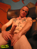 short-haired-man-with-long-cock-gets-fully-nude-and-shows-his-tattooed-body