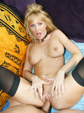 busty-blue-eyed-blonde-in-black-stockings-gets-her-ass-fucked-and-her-chest-creamed