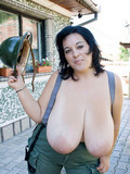 Flirtatious fire girl shows off her breathtakingly huge natural titties outdoors