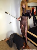 tall-mature-shemale-in-black-body-stocking-and-high-heel-boots-make-slave-man-taste-her-dick