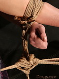 naked-juicy-brunette-with-shaved-pussy-gets-bound-with-ropes-suspended-and-screwed