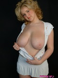 delicious-blonde-ashley-dressed-in-white-decides-to-show-you-her-monster-boobs