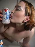 erotic-girl-with-tiny-tits-playing-with-lollipop-all-over-her-fresh-body