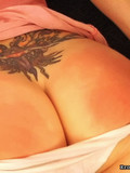 girl-pulls-down-her-white-cotton-panties-and-gets-her-tight-tattooed-ass-spanked