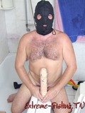 crazy-man-in-black-leather-mask-impales-his-ass-on-big-size-thick-dildo