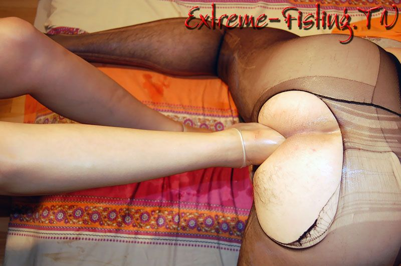 anal fisting pantyhose - Obedient bent over man in pantyhose gets his asshole fucked with one and  two feet