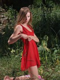 willing-to-enjoy-hot-summer-sun-naughty-teen-babe-strips-her-red-dress-to-tan-naked
