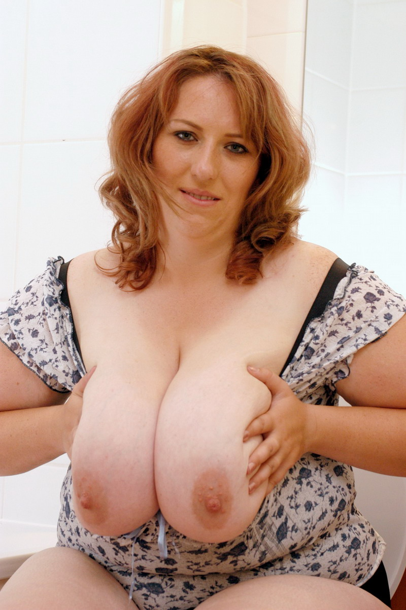 Plump redhead naked