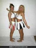 flirty-blonde-cheerleader-in-black-and-white-uniform-posing-and-flashing-her-panties