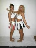 flirty-blonde-cheerleader-in-black-and-white-uniform-posing-and-flashing-her-panties