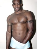fine-black-man-shows-off-his-great-muscles-outdoors-and-flashes-his-dick